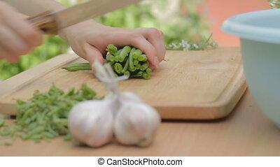 CLIP EDIT Chopping fresh green bean - CLIP EDIT Chopping...