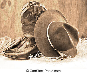 cowboy boots and hat - old style picture of cowboy boots and...