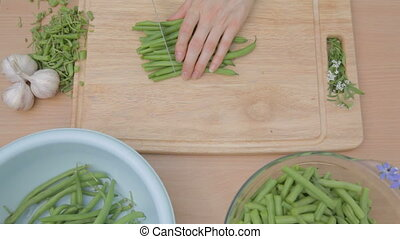 Cutting into long pieces fresh gree - Cutting fresh string...