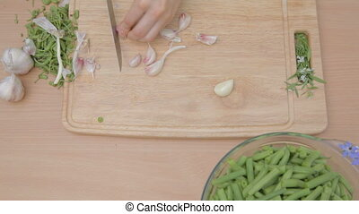 Cutting with knife garlic base and - Cutting with the knife...