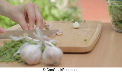 Cutting with knife garlic base and