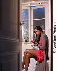 sad woman with pregnancy test kit - black woman with...