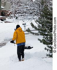 Shovelling sidewalk - A man shoceling his sidewalk.
