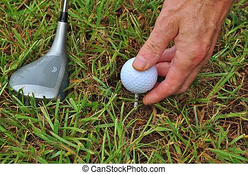 Golf Ball and Club - Placing the ball on the Golf Tee