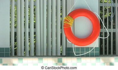 Life Saving Ring At Poolside - A life saving ring hangs by...