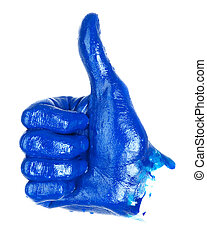 Thumbs up hand sign - male hand covered in a blue oil paint...