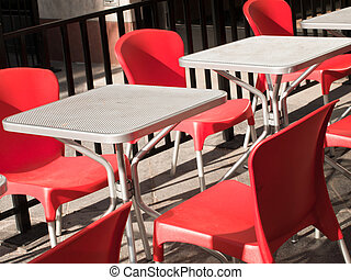Outdoor cafe with red chairs