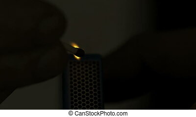 Matchstick lighted in the dark in s - Matchstick lighted in...