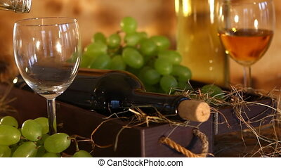 Pouring white wine into the glass - Beautiful composition of...