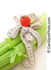 Green celery with tomato and tape measure, concept of...