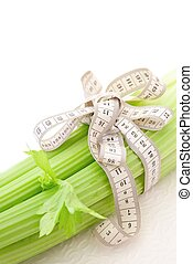 Celery with tape measure, concept of diet - Celery with tape...