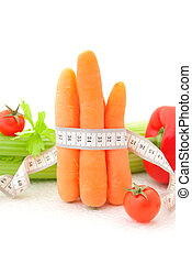 Carrot with tape measure and vegetables