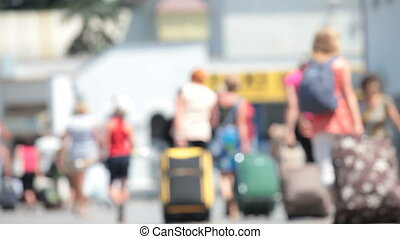 people with suitcases - anonymous people with suitcases walk...