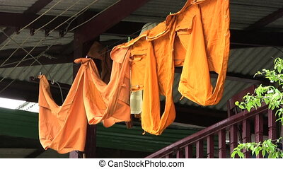 Monk Robes Hanging On The Line - Monks robes sway gently in...