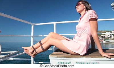woman resting on the deck - young woman resting on the deck...