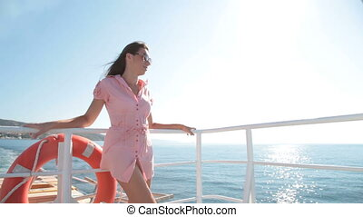 relaxing on the deck of ship - young woman relaxing on the...