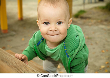 Little boy is playing on playground - Cute little boy is...