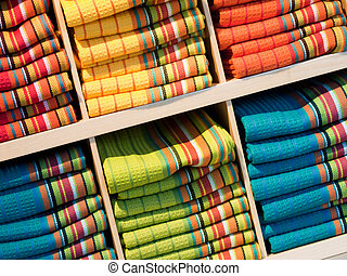 Kitchen Towels - Stack of color kitchen towels on display.