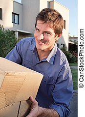 Portrait of smiling man holding box