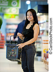 Happy Asian Female Shopper - A happy female asian woman with...