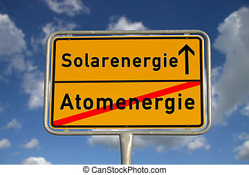 German road sign nuclear energy and solar energy with blue...