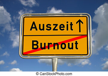 German road sign burnout and time-out with blue sky and...