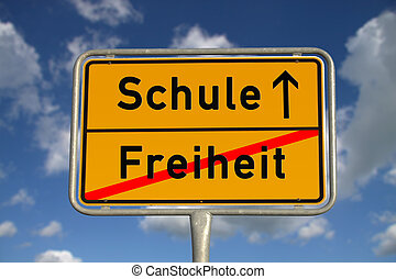 German road sign freedom and school with blue sky and white...
