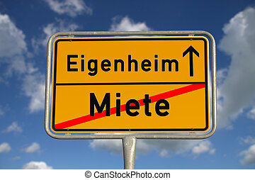 German road sign rental and owned home with blue sky and...