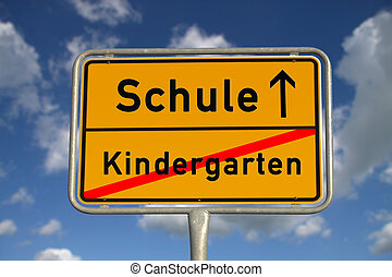 German road sign kindergarten and school with blue sky and...