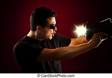 Man holding a light in front of his face