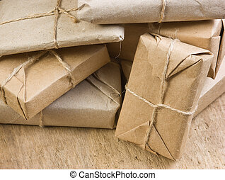 stack parcel in warehouse - pile parcel wrapped with brown...