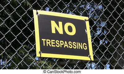 No Trespassing Sign - A No Trespassing Sign on a chain link...
