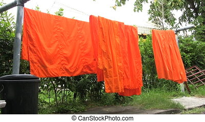 Monk Robes Hanging To Dry - Monks robes sway gently in the...