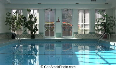 Man Walks By Indoor Pool