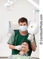 Man Dentist Preparing X-ray