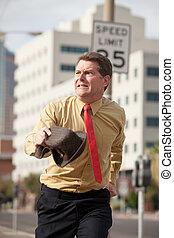 Businessmen In A Rush - Caucasian businessman runs on the...
