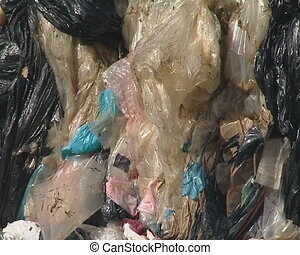 Large pressed polythene heaps prepared for recycling...