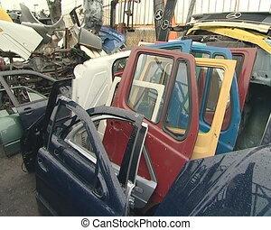 Large piles of hoods, bumpers, door