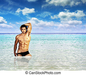 Sexy man in ocean - Portrait of a fit muscular male model...