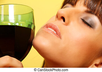 Woman with a wine glass - Closeup portrait of a latin woman...