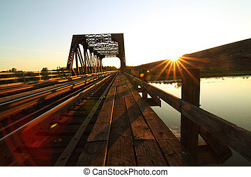 Steel Train Bridge - A view of a steel train bridge at...