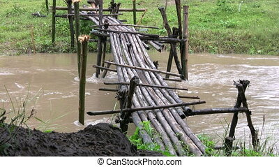 Man Crossing A Bamboo Bridge - A man comes across a rickety...