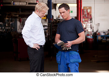 Confident Mechanic with Customer - A confident mechanic...
