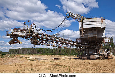 dredge - Big dredge on sandy open-cast mine against the sky