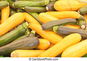 Courgettes - Mixed yellow and green courgettes as a...
