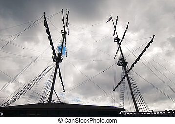 sailing ship masts and gunter silhouette at stormy sky