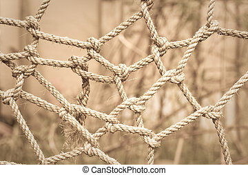 Complicated! - Conceptual sepia toned image of tangled rope