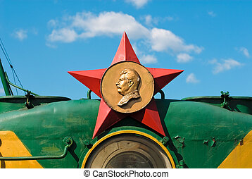 Red star with Stalin profile at the top of retro train