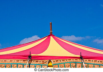 Circus tent top - A brightly colored circus tent top against...