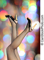 Elegant legs - Photo of the woman legs in black stockings on...